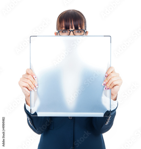 Cute young business woman shows transparently blank board