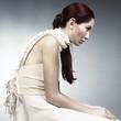 Sitting redhead in studio