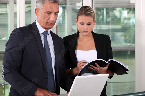 businessman and his young assistant working in the office