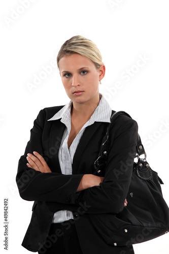 Unhappy woman arriving at work