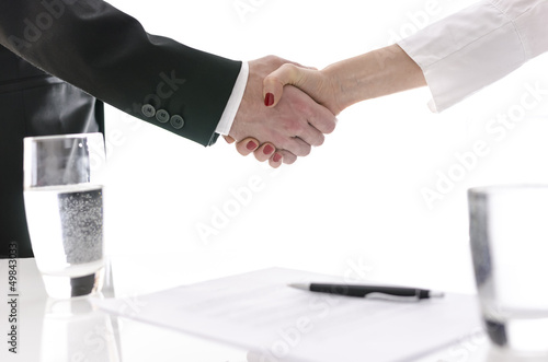 Handshake after signing a contract