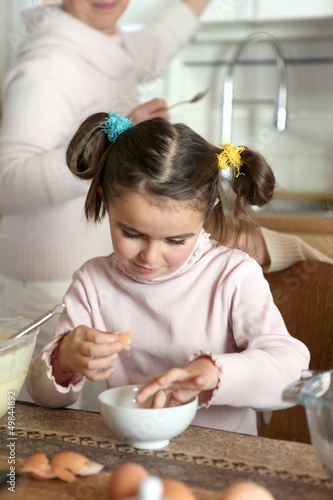 Little girl preparing eggs