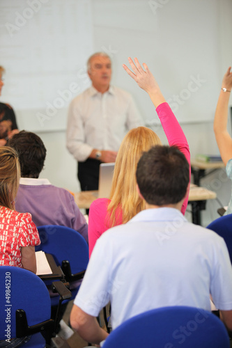 students attending lecture in university
