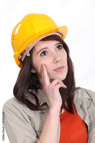 Tradeswoman daydreaming