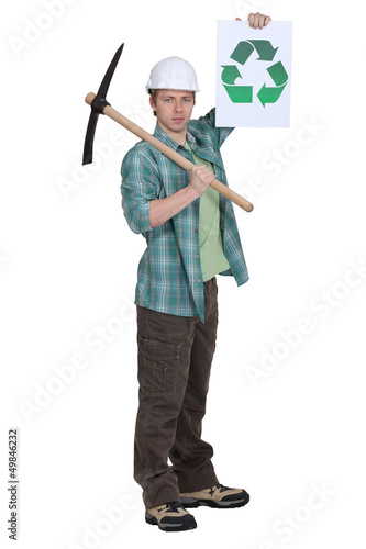 Man with pick-axe holding recycle logo