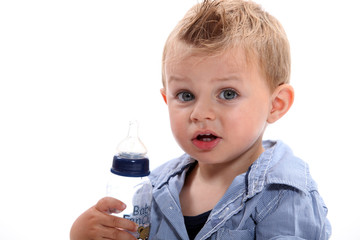 Boy holding bottle