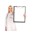 Young doctor holding clipboard