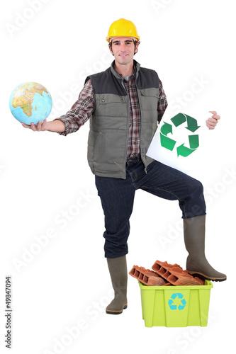 Worker holding globe