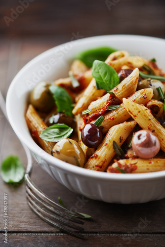 Penne pasta with dried tomato pesto and marinated olives