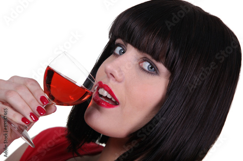 Brunette drinking from wine glass