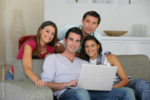Four friends looking at photos on the computer