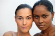 Two beautiful Caucasian and African women