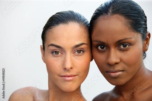 Two beautiful Caucasian and African women