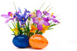 Colorful spring flowers and easter eggs.