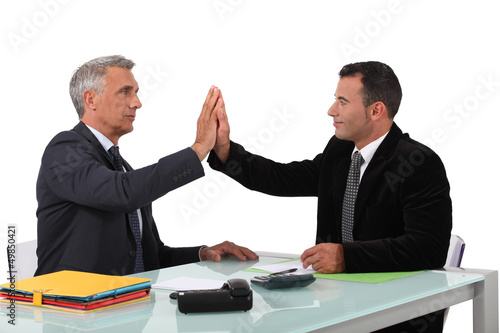business partners sitting at table