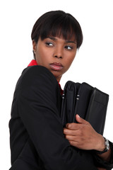 Nervous businesswoman has something to hide