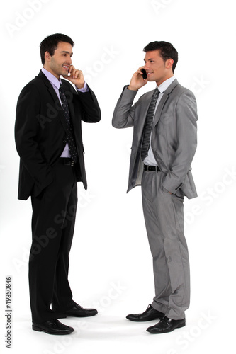 Young businessmen using cellphones