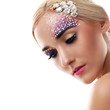 Closeup portrait of beautiful woman with artistic makeup