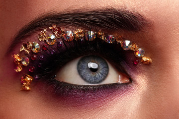 Closeup image of eye with artistic makeup