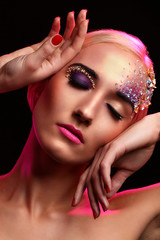 Portrait of beautiful woman with artistic makeup