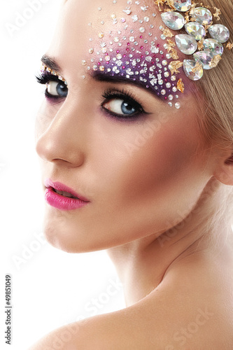 Closeup portrait of beautiful woman with artistic makeup