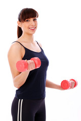 Happy caucasian woman with dumbbells