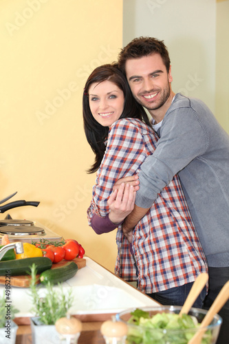 happy couple in a kitchen