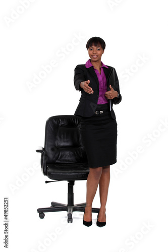 Businesswoman stretching hand for handshake
