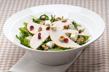 Fresh pears arugula gorgonzola cheese salad