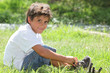 Child sitting in a field