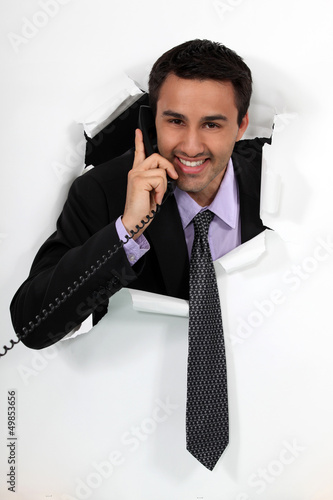 Office worker bursting through backdrop