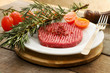 raw hamburger  with tomato, herbs and pink pepper