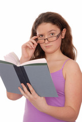 girl holds a  book