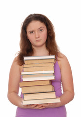 A girl holds a stack of books.