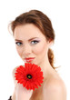 Beautiful young woman with bright make-up, holding flower,