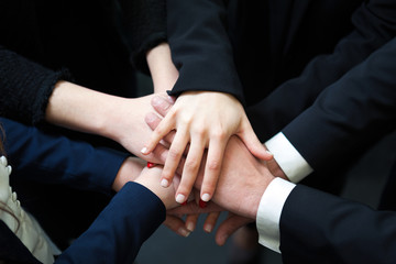 Closeup of pile of hands of business partners
