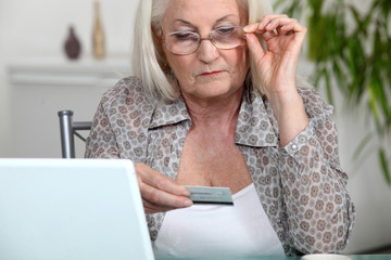 Older woman using her credit card online