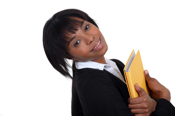 Businesswoman hugging a folder to her chest