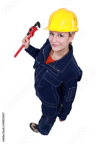 Female worker with a wrench