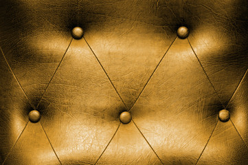 Luxury yellow leather close-up background