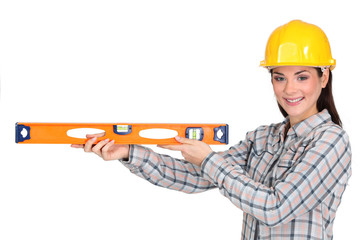 Tradeswoman holding a spirit level