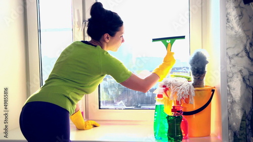 Women cleaning a window