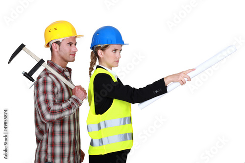 Tradesman following an engineer's orders