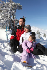 Portrait of a family on a skiing holiday together