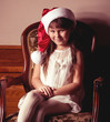 Beautiful little girl in Santa Claus clothes