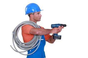 A handyman holding a drill.