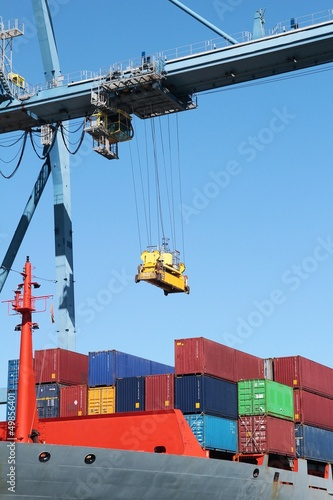 Container ship working with a crane in the port of Alicante