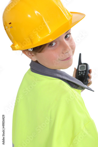 little girl dressed as site foreman