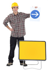Man holding traffic sign