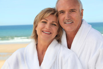 Couple at the beach in bathrobes